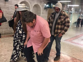 Victoria Small, her husband David (bent over in pink shirt), and their son, Jason, are pictured leaving a Newmarket courtroom on June 25, 2019. (Jane Stevenson, Toronto Sun)