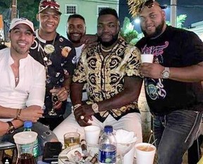 Big Papi, second from right, and pals celebrate hours before the legend was shot outside a club in Santo Domingo.