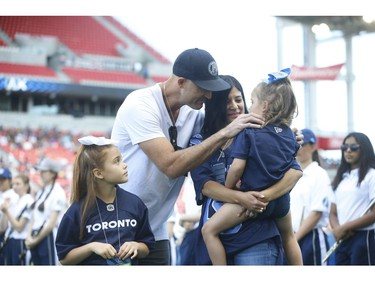 Toronto Argonauts quarterback Ricky Ray with his family acknowledges the crowd in a pre-game ceremony for his retitrement  Toronto, Ont. on Saturday June 22, 2019. Jack Boland/Toronto Sun/Postmedia Network