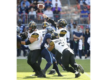 Hamilton Tiger Cats Jeremiah Masoli QB (8) fires a ball across the middle during the first quarter in Toronto, Ont. on Saturday June 22, 2019. Jack Boland/Toronto Sun/Postmedia Network