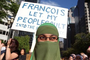 People protest Quebec's new Bill 21, which will ban teachers, police, government lawyers and others in positions of authority from wearing religious symbols such as Muslim head coverings and Sikh turbans, in Montreal, Quebec, Canada, June 17, 2019. (REUTERS/Christinne Muschi)