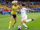 Allysha Chapman of Canada is challenged by Sofia Jakobsson of Sweden during the 2019 FIFA Women's World Cup France Round Of 16 match between Sweden and Canada at Parc des Princes on June 24, 2019 in Paris, France. (Photo by Richard Heathcote/Getty Images)