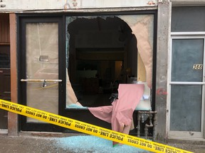 A man was wounded in a shooting at Queen St. and Spadina Ave. Bullets also hit the front of a store. (Ernest Doroszuk, Toronto Sun)