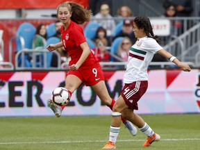 Team Canada's forward Jordyn Huitema gets off a pass in front of Team Mexico's defender Rebeca Bernal (4) during the second half of a women's international soccer friendly at BMO Field in Toronto, Saturday, May 18, 2019.