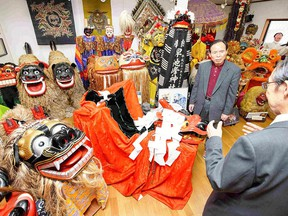 Yuichi Takahashi, right, collected various large shishi in Japan and abroad. Each has a different expression and a distinctive personality. (Photo for The Japan News by Taku Yaginuma)