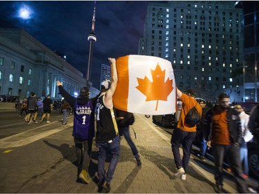 Fans fill the streets of downtown Toronto, Ont. celebrating the Toronto Raptors victory over the Golden State Warriors in the NBA Finals on Friday June 14, 2019.