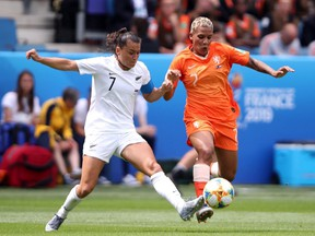 Ali Riley of New Zealand battles for possession with Shanice Van De Sanden of the Netherlands during the 2019 FIFA Women's World Cup France group E match between New Zealand and Netherlands at  on June 11, 2019 in Le Havre, France.