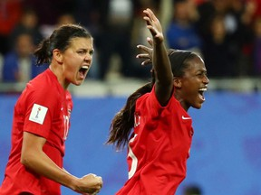 Nichelle Prince celebrates scoring Canada's second goal with Christine Sinclair against New Zealand at the 2019 Women's World Cup in Grenoble, France on Saturday, June 15, 2019.
