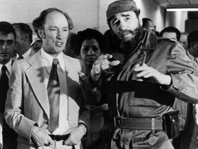 Prime Minister Pierre Trudeau looks on as Cuban President Fidel Castro gestures during a visit in Havana on Jan. 27, 1976.