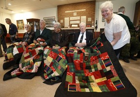 Eleanor Ross poses with 48th Highlander members Sgt. Ken Wells 95, Major Tom White 97, Master Sgt. Herb Pike, 94 and Master Warrant Officer George McLean 99. She made quilts for the men and presented them in honour of the 75th anniversary of D-Day at Moss Park Armoury on Tuesday June 4, 2019.