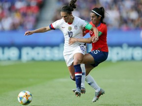 Carli Lloyd of the U.S. is challenged by Su Helen Galaz of Chile during the 2019 Women's World Cup Group F match at Parc des Princes in Paris on Sunday, June 16, 2019.