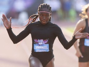 Crystal Emmanuel reacts as she crosses the finish line in the women's 100-metre semifinals at the Canadian Championships in Montreal on Friday, July 26, 2019.