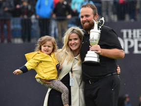 Ireland's Shane Lowry poses with his family and the Claret Jug, the trophy for the Champion golfer of the year after winning the British Open golf Championships at Royal Portrush golf club in Northern Ireland on July 21, 2019.