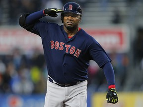 David Ortiz of the Boston Red Sox salutes as he round second base after hitting a home run against the New York Yankees May 6, 2016 in New York.