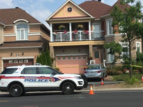 York Regional Police at a home on Castlemore Ave. in Markham on Monday, July 29, 2019, the day after four people were found murdered. (Kevin Connor/Toronto Sun)
