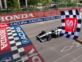 Simon Pagenaud of France crosses the finish line to win the 2019 Honda Indy Toronto, in Toronto, Sunday July 14, 2019.