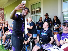 Baltimore Ravens quarterback Lamar Jackson (8) takes a picture with fans during training camp at Under Armour Performance Center. (Evan Habeeb-USA TODAY Sports)