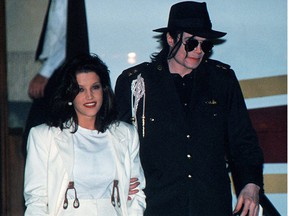 This Aug. 16, 1994, file photo shows Michael Jackson and his then wife Lisa-Marie Presley arriving at the airport in Budapest.