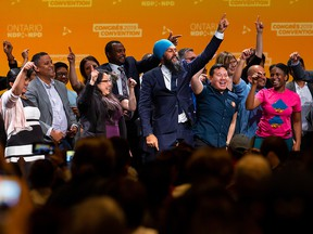 NDP Leader Jagmeet Singh dances on stage with party members and supporters after speaking at the Ontario NDP Convention in Hamilton, Ont., Sunday, June 16, 2019.