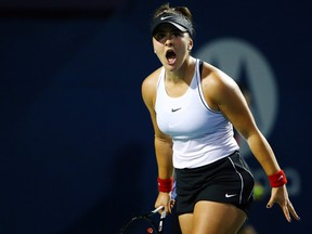 Bianca Andreescu celebrates a point against Eugenie Bouchard during in a first round match on Day 4 of the Rogers Cup at Aviva Centre on August 6, 2019 in Toronto.  (Vaughn Ridley/Getty Images)