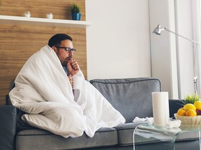 Young man suffering from cold and coughing. (Getty Images)
