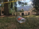 A discarded liquor bottle outside 37 The Bridle Path in Nork York, the site of an early-morning shooting on Sunday, Aug. 4 2019.