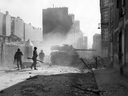 A U.S. tank destroyer fires at a Nazi bunker location to clear a path through a side street in Brest, France, in September 1944. (AFP/Getty Images)