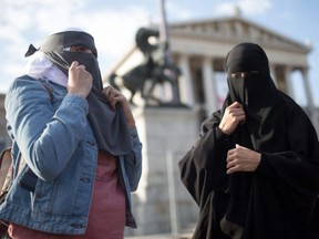 Women wear a traditional hijab headdress protest against Austria's ban on full-face Islamic veils in Vienna, Austria, on Oct. 1, 2017.