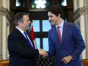 Prime Minister Justin Trudeau, right, shakes hands with Alberta Premier Jason Kenney in his office on Parliament Hill in Ottawa on Thursday, May 2, 2019. (THE CANADIAN PRESS/Sean Kilpatrick)