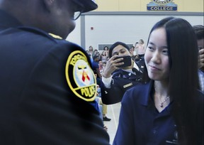 153 graduates between the ages of 15-18 were all smiles as they lined up to shake hands with Police Chief Mark Saunders, Mayor John Tory, and other dignitaries after completing this year's Youth In Policing Initiative (YIPI) eight - week summer program on Thursday August 22, 2019