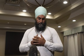 "NDP Leader Jagmeet Singh comments on a photo from 2001 surfacing of Liberal Leader Justin Trudeau wearing ""brownface"" as he makes a statement in Toronto, Wednesday September 18, 2019. (THE CANADIAN PRESS/Adrian Wyld)"