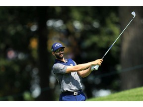 Adam Hadwin of Canada plays a shot on the 14th hole during the second round of the BMW Championship at Medinah Country Club No. 3 on August 16, 2019 in Medinah, Illinois.