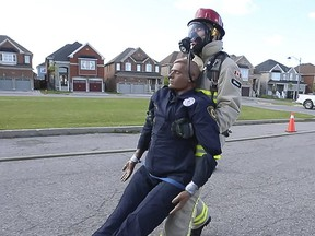 A firefighter trains for an upcoming international competition. (Jack Boland, Toronto Sun)