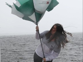 Jennifer Temeloski struggles to hold her umbrella in Stuart, Fla. as Dorian inches towards the U.S. on Sept. 2, 2019. (Getty Images)