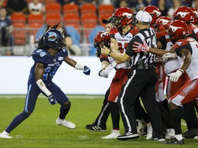 Toronto Argonauts defensive back Abdul Kanneh gets into an argument with members of the Calgary Stampeders during second half of CFL action in Toronto, Friday, Sept. 20, 2019. THE CANADIAN PRESS/Cole Burston