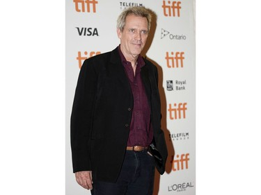 """English actor Hugh Laurie arrives for the special presentation of """"The Personal History of David Copperfield"""" during the Toronto International Film Festival, on Sept. 5, 2019, in Toronto."""