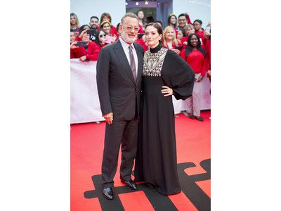 Actor Tom Hanks and director Marielle Heller arrive for the premiere of