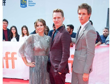 """(L-R) Actress Felicity Jones, director Tom Harper and actor Eddie Redmayne attend """"The Aeronauts"""" premiere at the Roy Thompson Hall during the 2019 Toronto International Film Festival Day 4 on Sept. 8, 2019, in Toronto."""