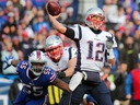 Jerry Hughes of the Buffalo Bills attempts to sack Tom Brady of the New England Patriots as he throws on December 3, 2017 at New Era Field in Orchard Park, N.Y. (Brett Carlsen/Getty Images)