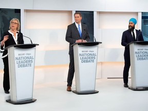 Green Party leader Elizabeth May, Conservative leader Andrew Scheer and New Democratic Party (NDP) leader Jagmeet Singh take part in the Maclean's/Citytv National Leaders Debate in Toronto, Ontario, Canada September 12, 2019. Frank Gunn/Pool via REUTERS ORG XMIT: TOR501