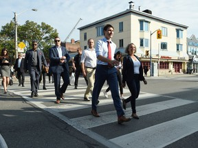 Liberal Leader Justin Trudeau crosses a street as he makes his way to make a policy announcement in Toronto on Friday, Sept. 20, 2019.