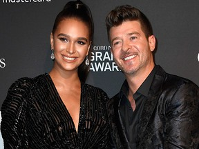 Robin Thicke (R) and April Love Geary attend the Pre-Grammy Gala at The Beverly Hilton Hotel on Feb. 9, 2019 in Beverly Hills, Calif. (Photo by /)