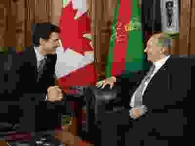 Justin Trudeau is pictured with Aga Khan. Trudeau was found to have violated ethics rule's in 2017 after he accepted a trip to Khan's island in the Bahamas. Trudeau did not advise the conflict of interest commissioner of his friendship with Khan and admitted to using Khan's personal helicopter.