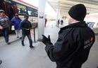 TTC fare inspector checks tickets at Bathurst station