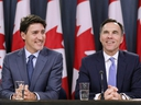 Prime Minister Justin Trudeau and Finance Minister Bill Morneau react during a news conference about the government's decision on the Trans Mountain Expansion Project in Ottawa, June 18, 2019. REUTERS/Chris Wattie
