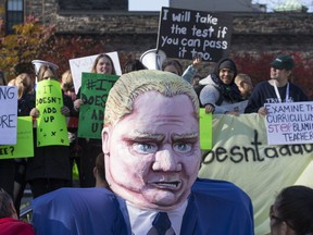 Protesters targeting Premier Doug Ford's PC government converged on the opening day of the fall session at Queen's Park on Oct. 28, 2019. (Craig Robertson, Toronto Sun)