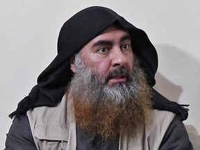 In this photo taken on April 30, 2019 from a video released by Al-Furqan media, the chief of the Islamic State group Abu Bakr al-Baghdadi purportedly appears for the first time in five year. (Photo by AFP via Getty Images)