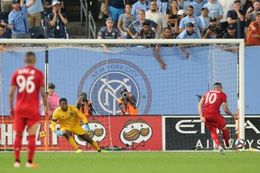 TFC's Alejandro Pozuelo scores a goal on a penalty kick against New York City FC's Sean Johnson at Yankee Stadium in September. The teams will play at Citi Field on Wednesday night.(USA TODAY SPORTS)