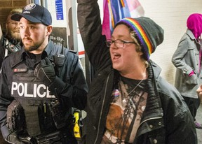 Protestors leave the Palmerston Library following a talk by controversial speaker Meghan Murphy at the basement theatre  in Toronto, Ont. on Tuesday October 29, 2019.