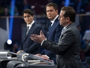 Liberal leader Justin Trudeau, left to right, Conservative leader Andrew Scheer and Bloc Quebecois leader Yves-Francois Blanchet take part in the leaders' French language debate in Gatineau, Que. on Thursday, October 10, 2019. (THE CANADIAN PRESS/Chris Wattie)